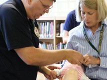 Instructor teaching CPR