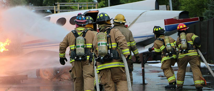 Firefighters extinguishing aircraft fire