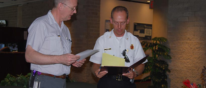 firefighter giving inspection