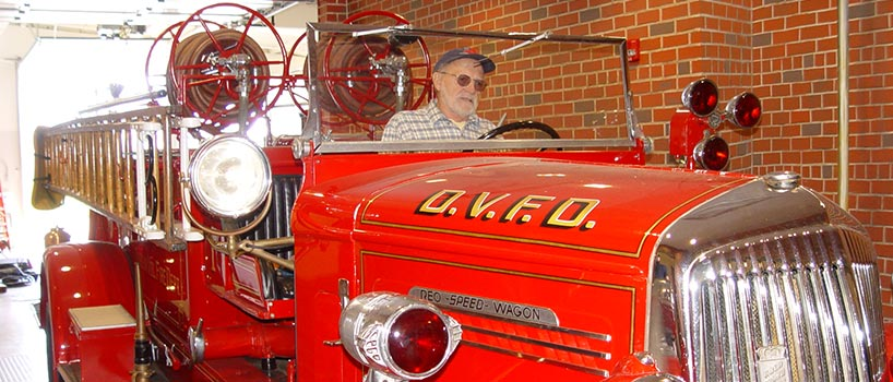 Man in vintage fire truck